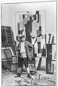 Picasso vor dem 1916 im Atelier in der Rue Schoelcher, Paris, überarbeiteten Homme accoudé sur une table (endgültiger Zustand), 1916